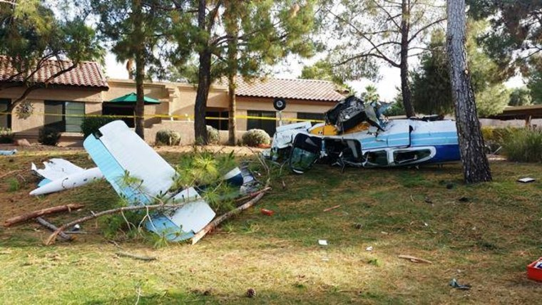Wreckage from a small single engine plane that crashed in the active adult community of Sun Village, located in the city of Surprise, Arizona, on Saturday, May 7, 2016.