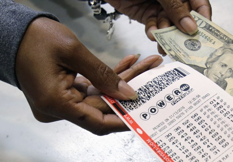 In this Jan. 13, 2016 file photo, a clerk hands over a Powerball ticket for cash at Tower City Lottery Stop in Cleveland. Powerball estimates that its jackpot for the May 4, 2016, drawing is $348 million.