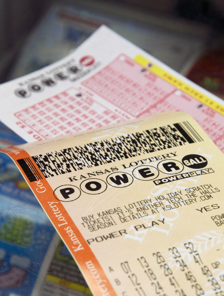 A Powerball form and purchased ticket are on the counter at the Jayhawk Food Mart in Lawrence, Kan., Friday, Nov. 23, 2012.