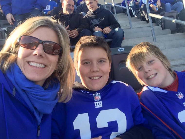 Julie Holcombe with her sons Ryan and Patrick, 12.