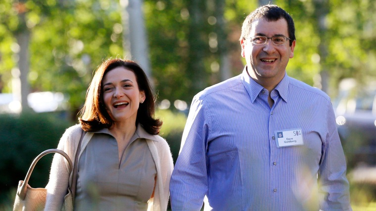 Sheryl Sandberg, Chief Operating Officer (COO) of Facebook, arrives with her husband David Goldberg, CEO of SurveyMonkey, for the first day of the Allen and Co. media conference in Sun Valley, Idaho in this July 9, 2014, file photo.