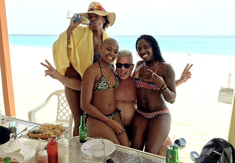 Calvin Ayre poses with women in Antigua in an image posted to his Facebook page.