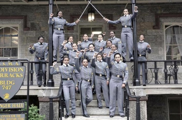 This undated image obtained from Twitter on May 7 shows 16 black, female cadets in uniform with their fists raised while posing for a photograph at the United States Military Academy at West Point, N.Y.