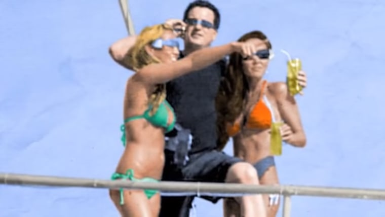 Screengrab of Calvin Ayre on a yacht.