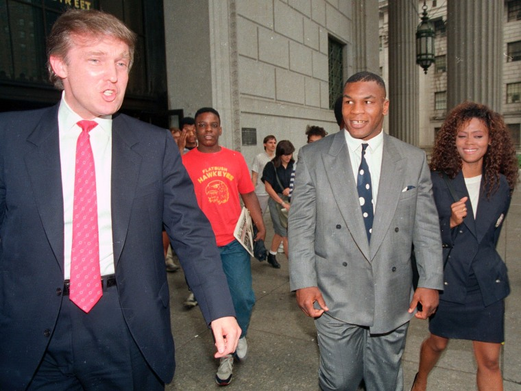Image: Heavyweight champion Mike Tyson, his wife, actress Robin Givens and Donald Trump, left