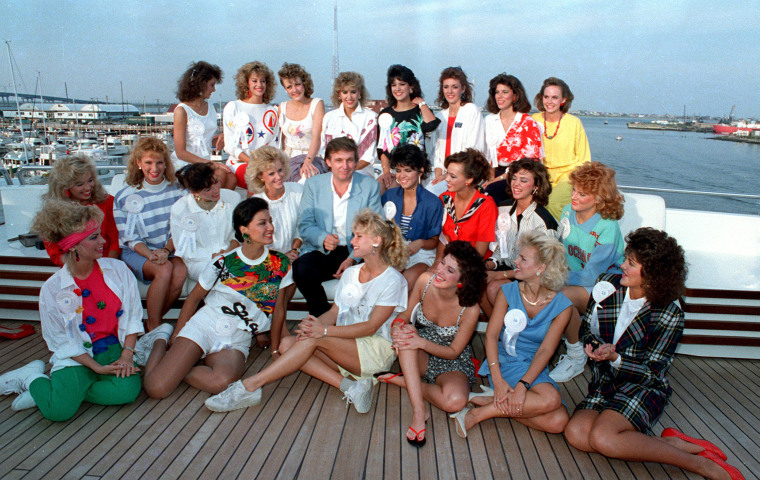 Image: Trump poses with about half of the competing State Misses on board his yacht in Atlantic City