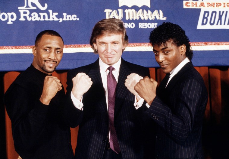 Image: Trump is flanked by super middleweight champion Thomas Hearns and Michael Olajide