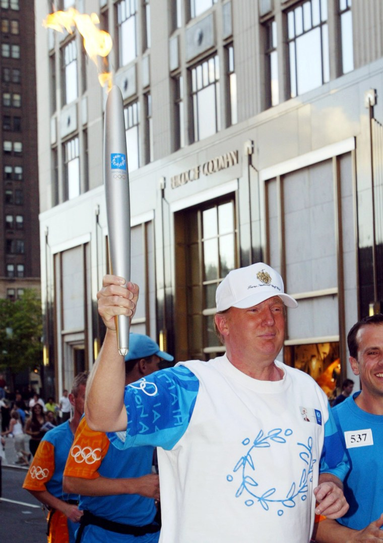 Image: Trump carries the Olympic flame in June 2004