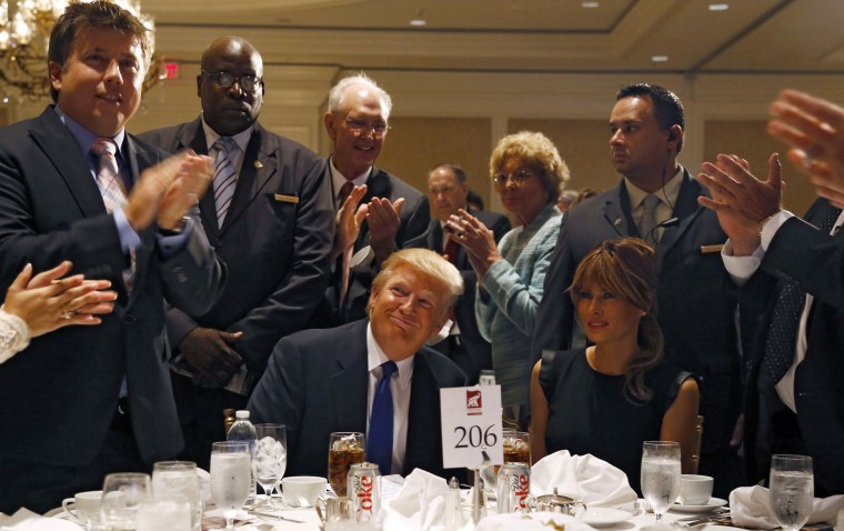 Image: Trump and his wife Melania are applauded before a dinner hosted by the Sarasota Republican Party