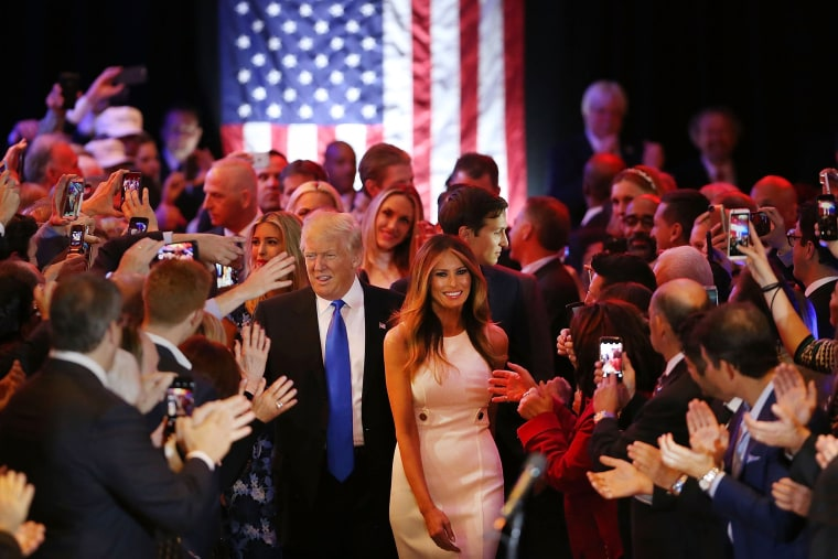 Image: Trump and his wife Melania Trump arrive to speak to supporters at Trump Tower