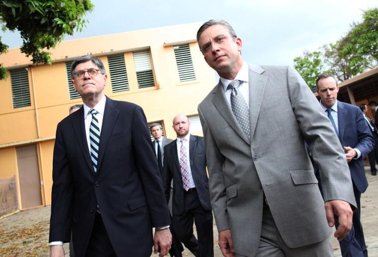 U.S. Treasury Secretary Jack Lew and Puerto Rico's Governor Alejandro Garcia Padilla visit the elementary school Eleonor Roosevelt in San Juan