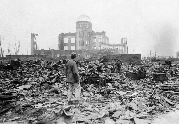 In this Sept. 8, 1945 file photo, an allied correspondent stands in the rubble in front of the shell of a building that once was a movie theater in Hiroshima, Japan, a month after the first atomic bomb ever used in warfare was dropped by the U.S. on Aug. 6, 1945.