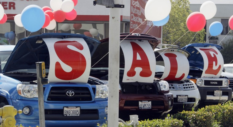 "In this Sept. 18, 2010 photo, ""Sale"" is spelled out in the open hoods of used cars at a Toyota dealership in Glendale, Calif."