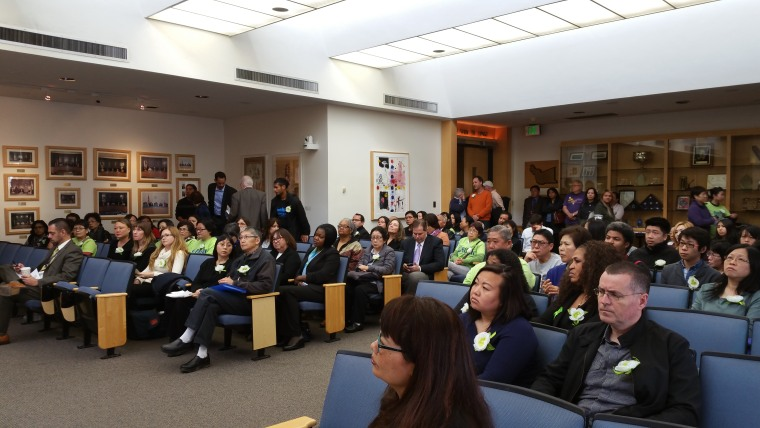 Supporters of ACMHS staff at an Alameda County health meeting Monday, Jan. 9 speaking on the results of an audit of the organization.