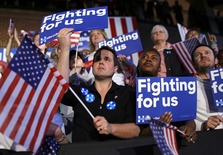 Image:  Supporters cheer as they listen to Hillary Clinton