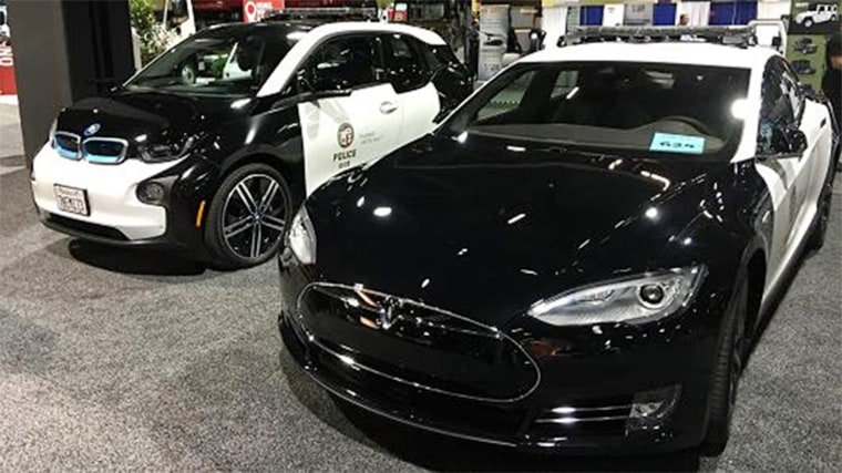 L.A. Police Department's BMW i3 and Tesla Model S cars on display at recent trade show.