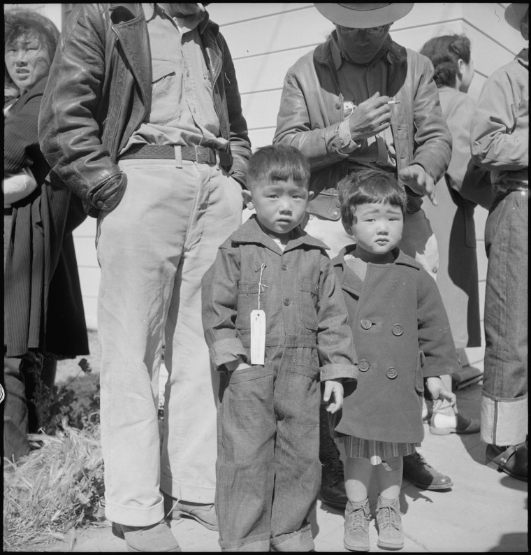 Original WRA caption: Turlock, California. These children have just arrived at Turlock Assembly center. Evacuees of Japanese ancestry will be transferred later to a War Relocation Authority center for the duration.