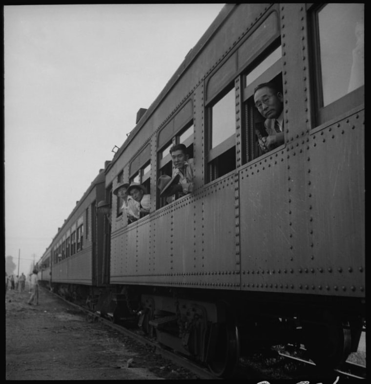 May 20, 1942. Woodland, California. Original caption: Evacuees of Japanese ancestry from this rich agricultural district are on their way to Merced Assembly center. This special train consists of ten cars.