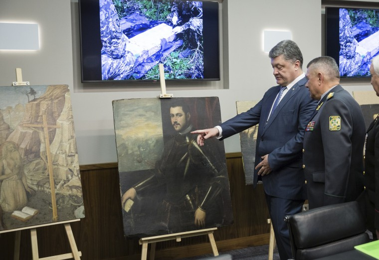 IMAGE: Ukraine President Petro Poroshenko with stolen paintings