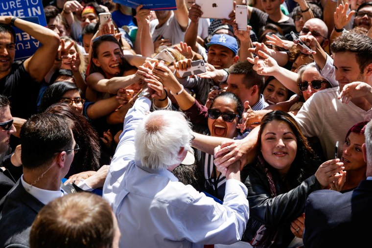 Image: U.S. Democratic presidential candidate Bernie Sanders greets supporters at a campaign rally in Stockton