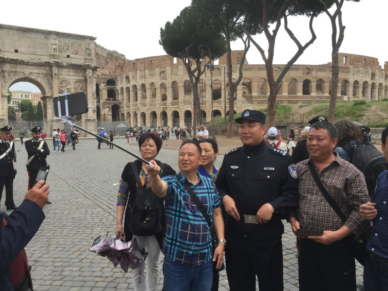 Chinese tourists take a selfie with Pang Bo in Rome.