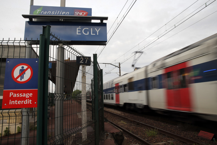 A train starts at the Egly station, south of Paris, on May 11, 2016. French authorities opened an investigation Wednesday after a teenage woman allegedly live-streamed video of her suicide on the popular app Periscope. The local prosecutor said the young woman threw herself under a commuter train in the suburban Egly station, south of Paris.