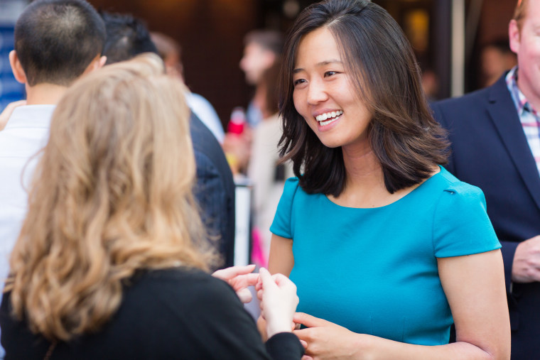Boston City Councilor At-Large Michelle Wu, right, speaks with a constituent at a neighborhood event in July 2015. Wu was elected as the first woman of color to be president of the Boston City Council in January 2016.