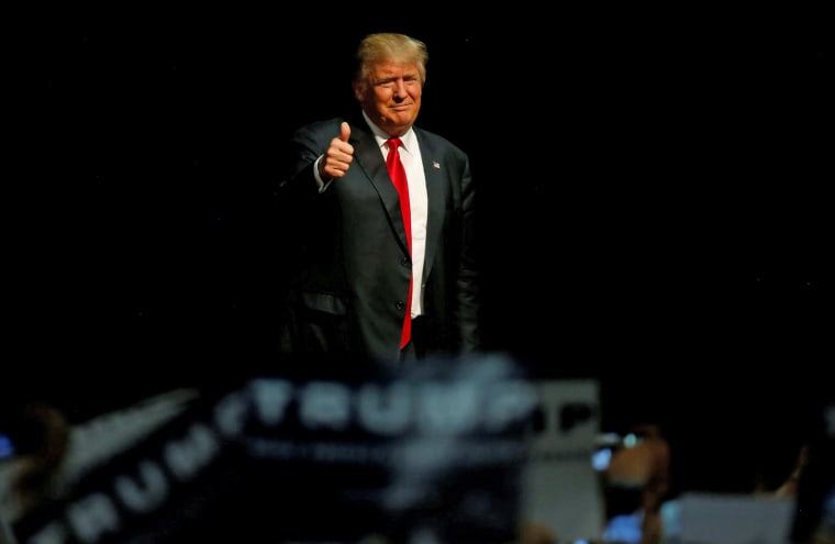Image: Republican U.S. presidential candidate Donald Trump arrives at a campaign rally in Eugene