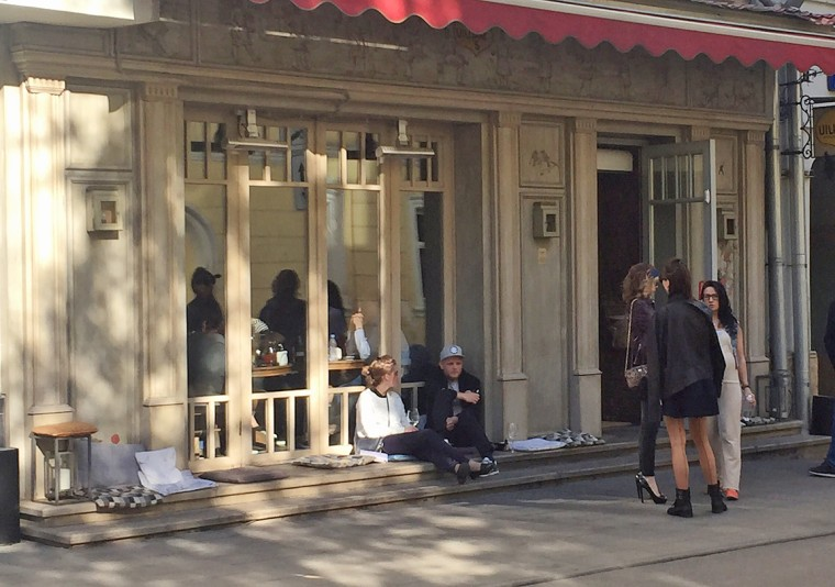 People stand outside a cafe in central Moscow.