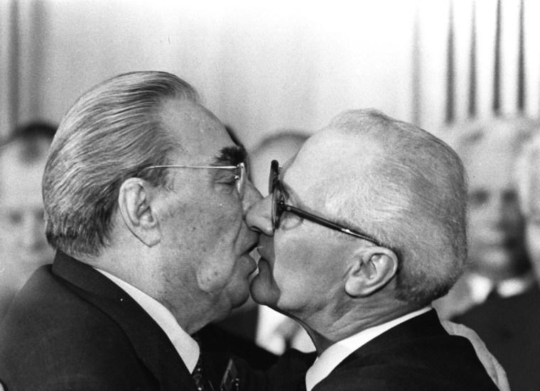 Soviet President Leonid Brezhnev and East German leader Erich Honecker exchange kisses in 1979 after Brezhnev was honored as part of celebrations marking the 30th anniversary of the founding of East Germany.