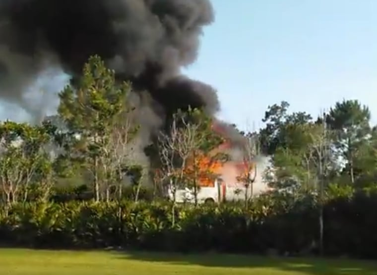 An image from a video shot by a passerby shows a bus burning after it was struck by an SUV near Animal Kingdom in Disney World in Orange County, Florida, on Saturday, May 14, 2016.