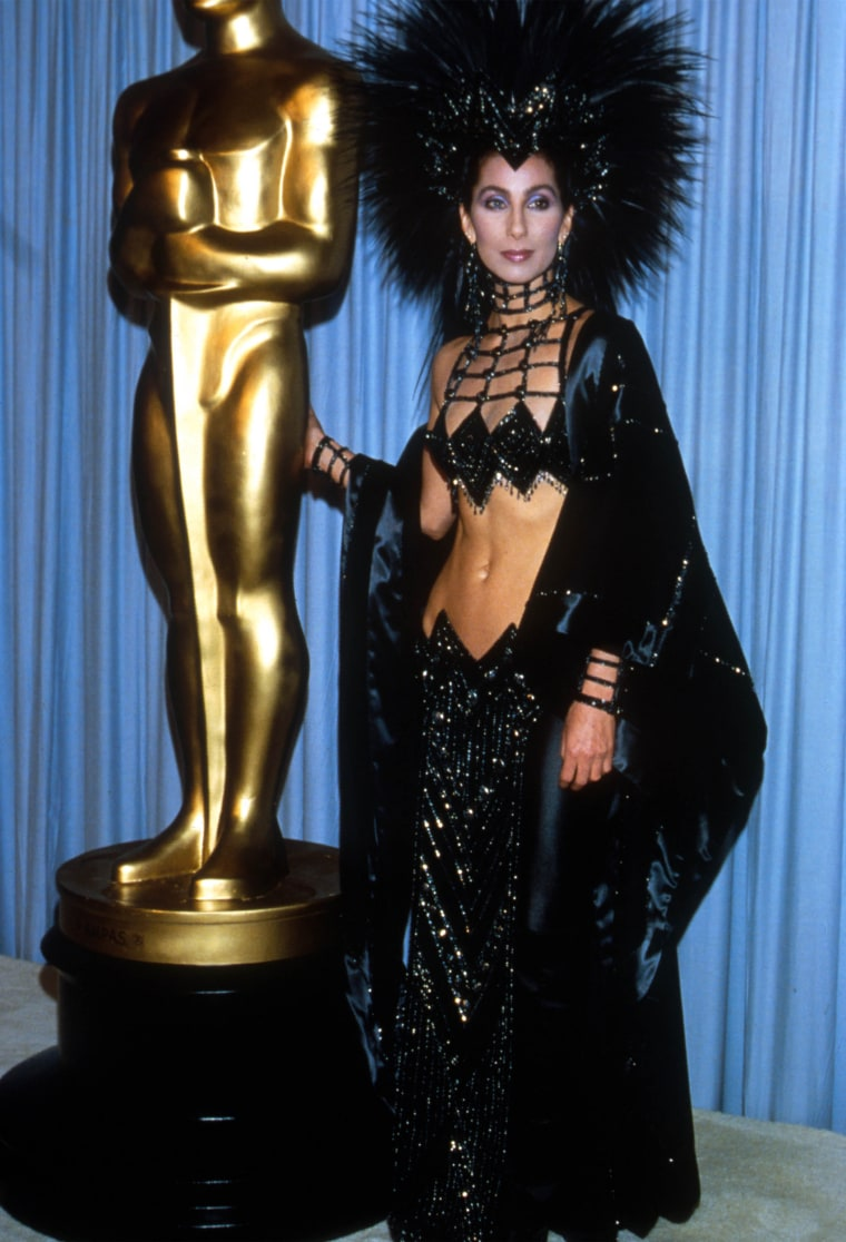 "Cher Wins the Oscar for Best Actress in her role in ""Moonstruck"" at the 1986 Academy Awards. She wore a Bob Mackie outfit."