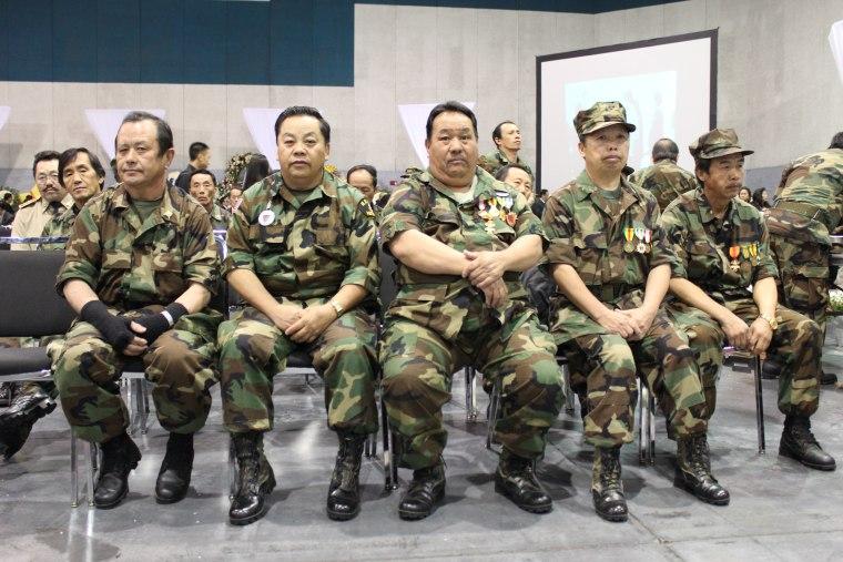 Hmong veterans of the Secret War in Laos attending General Vang Pao's funeral in Fresno, California, in 2011.
