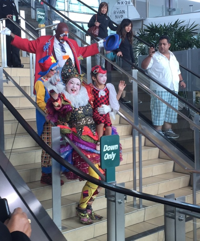 Fern Street Circus performers entertain travelers at the San Diego International Airport.
