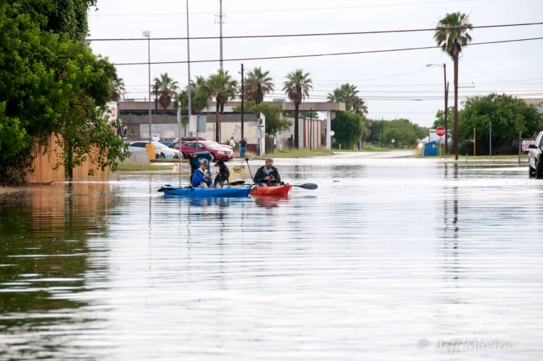 Aerials shots of people kayaking in the flooding of the City of Aransas Pass, Texas on May 16. The city received over 12 inches of rain in a five hour period.