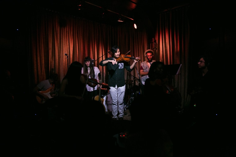 """Peter Su performing at the Hotel Cafe during his album launch party for """"Lions on the Beach."""""""