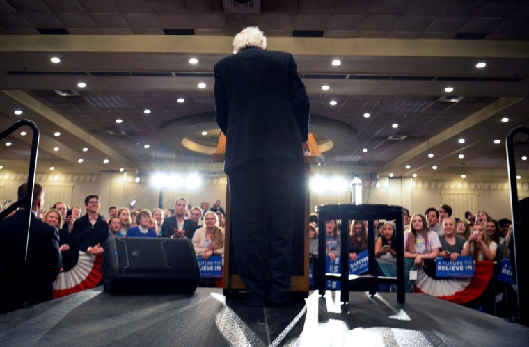 Image: Democratic presidential candidate Bernie Sanders speaks with supporters during a rally in Fargo