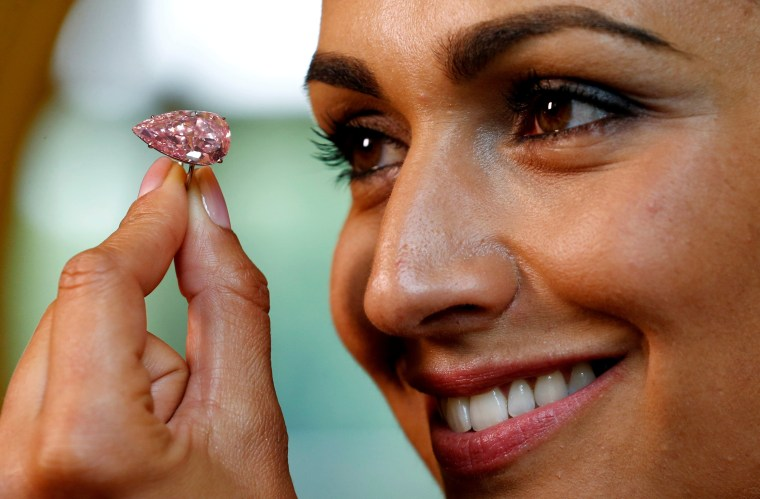 "Image: A model poses with the ""Unique Pink"" at Sotheby's auction house in Geneva"