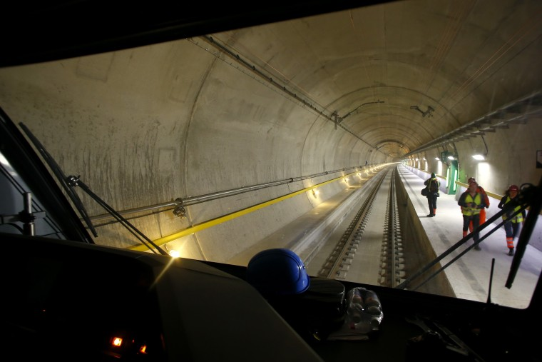 Image: Visitors stand on the emergency platform inside the Gotthard Base Tunnel near Sedrun, Switzerland, in March.