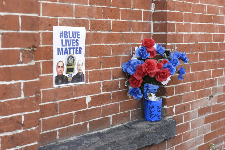This 'Blue Lives Matter' poster was placed on a brick wall near the site where New York City police officers Wejian Liu and Rafael Ramos were shot and killed at point-blank range in their patrol car in December 2010.