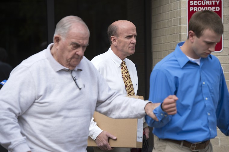 Calvin Harris, center, leaves Schoharie County Court following closing arguments during his fourth trial in Schoharie, N.Y. on Wednesday, May 18, 2016.