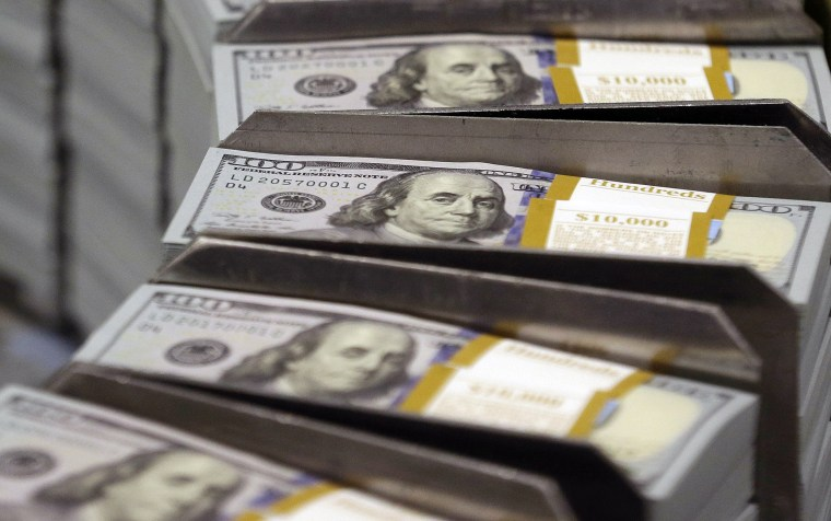 Image: Freshly cut stacks of $100 bills