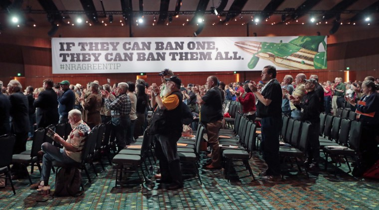 National Rifle Association members applaud a speech during the annual meeting of members at the NRA convention Saturday, April 11, 2015, in Nashville, Tenn.