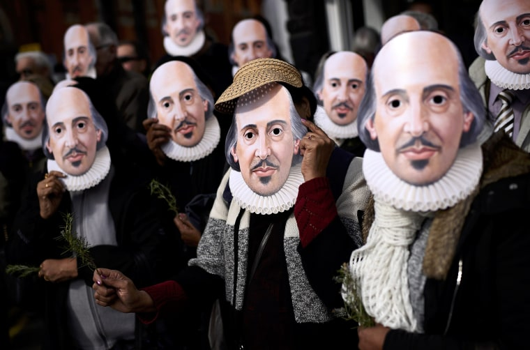 Image: People hold up face masks with William Shakespeare's portrait during celebrations to mark the 400th anniversary of the playwright's death in the city of his birth, Stratford-Upon-Avon