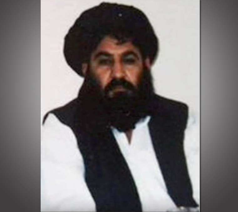 This handout photo released by the Afghan Taliban on December 3, 2015, which was taken on a mobile phone in mid-2014, is said to show Afghan Taliban leader Mullah Akhtar Mansour posing for a photograph at an undisclosed location in Afghanistan.