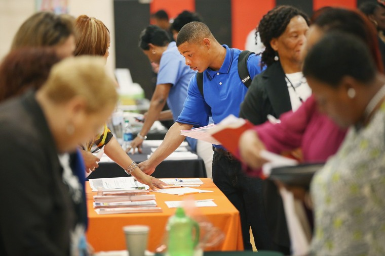 Image: Job seekers check out opportunities at a job fair on June 12, 2014 in Chicago