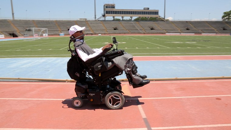 Edwards, visiting the football field where his paralyzing accident occurred when he was 17.