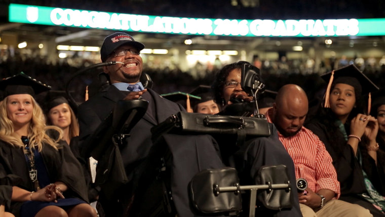 Derrick Edwards cheering during Hoda Kotb's commencement speech at Tulane University earlier this month.