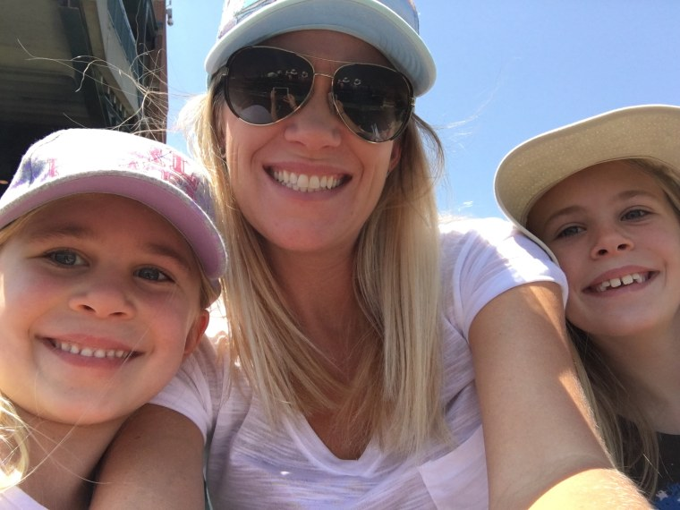Eden attends a baseball game with mother Kylee and sister Isabella.