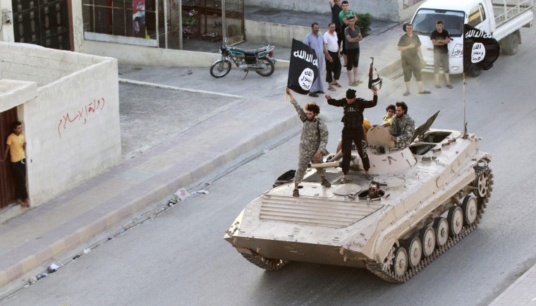 Image: Militants brandish the flag if ISIS in Raqqa in this 2014 file photo.